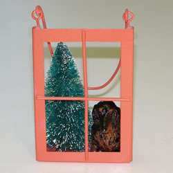 Black/tan Longhair Dachshund In The Window Christmas Ornament